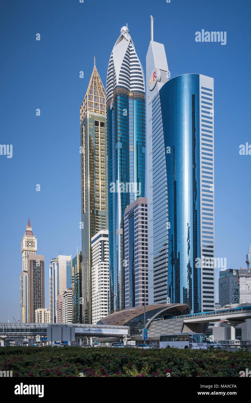 The Metro Station and tall office towers in the Financial district of downtown Dubai, UAE, Middle East. - Stock Image