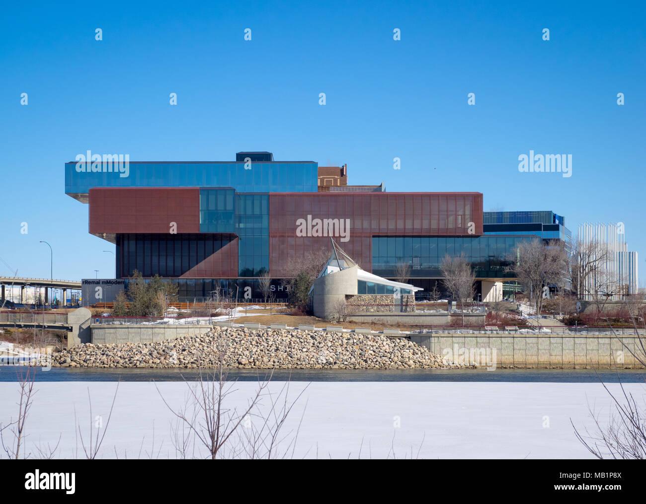 The exterior of the Remai Modern Art Gallery as seen from across the frozen South Saskatchewan River in Saskatoon, Saskatchewan, Canada. - Stock Image