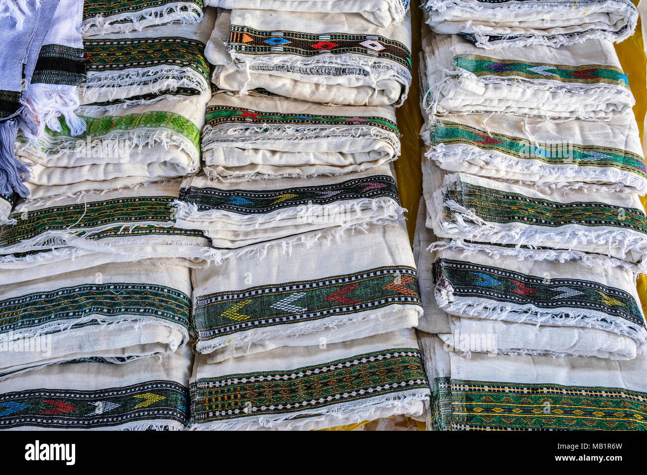 Colorful traditional Ethiopian textiles at a market in Hawzien, Tigray region, Ethiopia. - Stock Image
