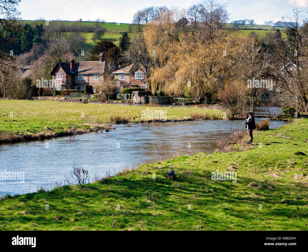 Peak District National Park. 5th Apr, 2018. UK Weather: fly fisherman enjoying the glorious sunshine on Thursday after the wet Easter Bank Holiday break at Ashford on the Water, near Bakewell in the Peak District National Park Credit: Doug Blane/Alamy Live News - Stock Image