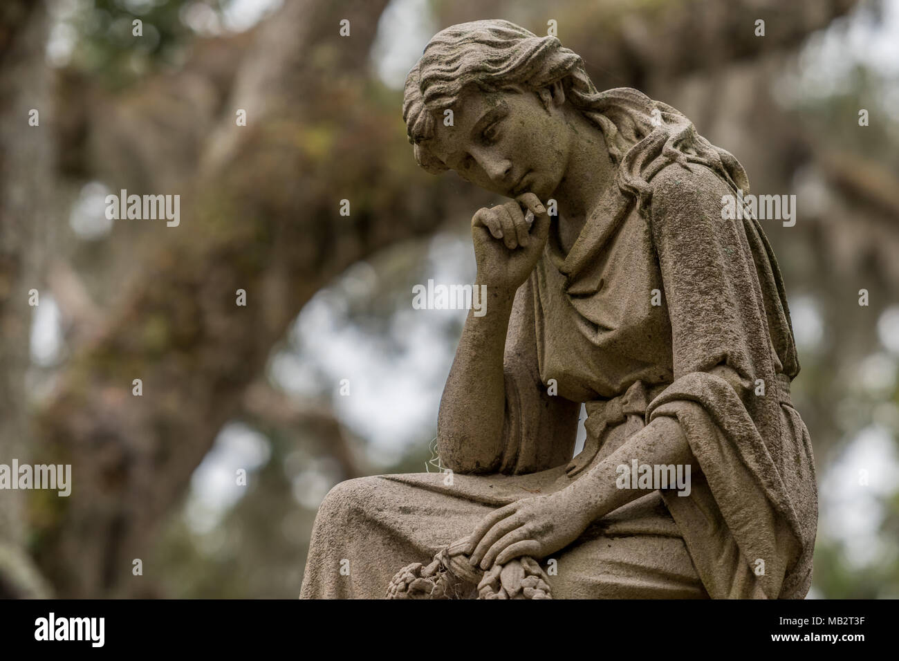 Thinking Woman with Copy Space Left in southern cemetery - Stock Image