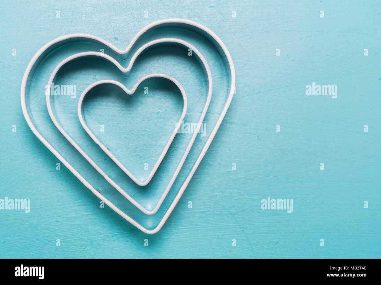 Three Heart Cookie Cutters With Copy Space to right - Stock Image