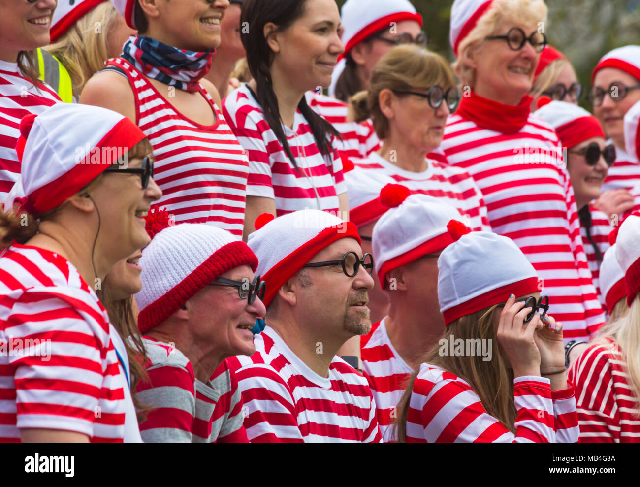 Poole, Dorset, UK. 7th April, 2018. Where's Wally Poole Park Run. Poole Park Run celebrate their 7th year anniversary with a Where's Wally themed run. The wet weather didn't deter Wally! Credit: Carolyn Jenkins/Alamy Live News - Stock Image