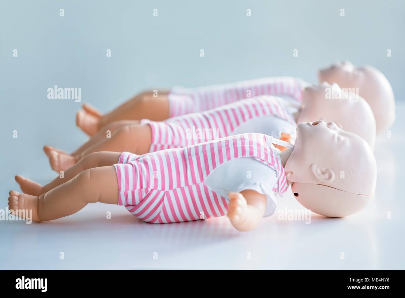 Infant CPR training dummies. - Stock Image