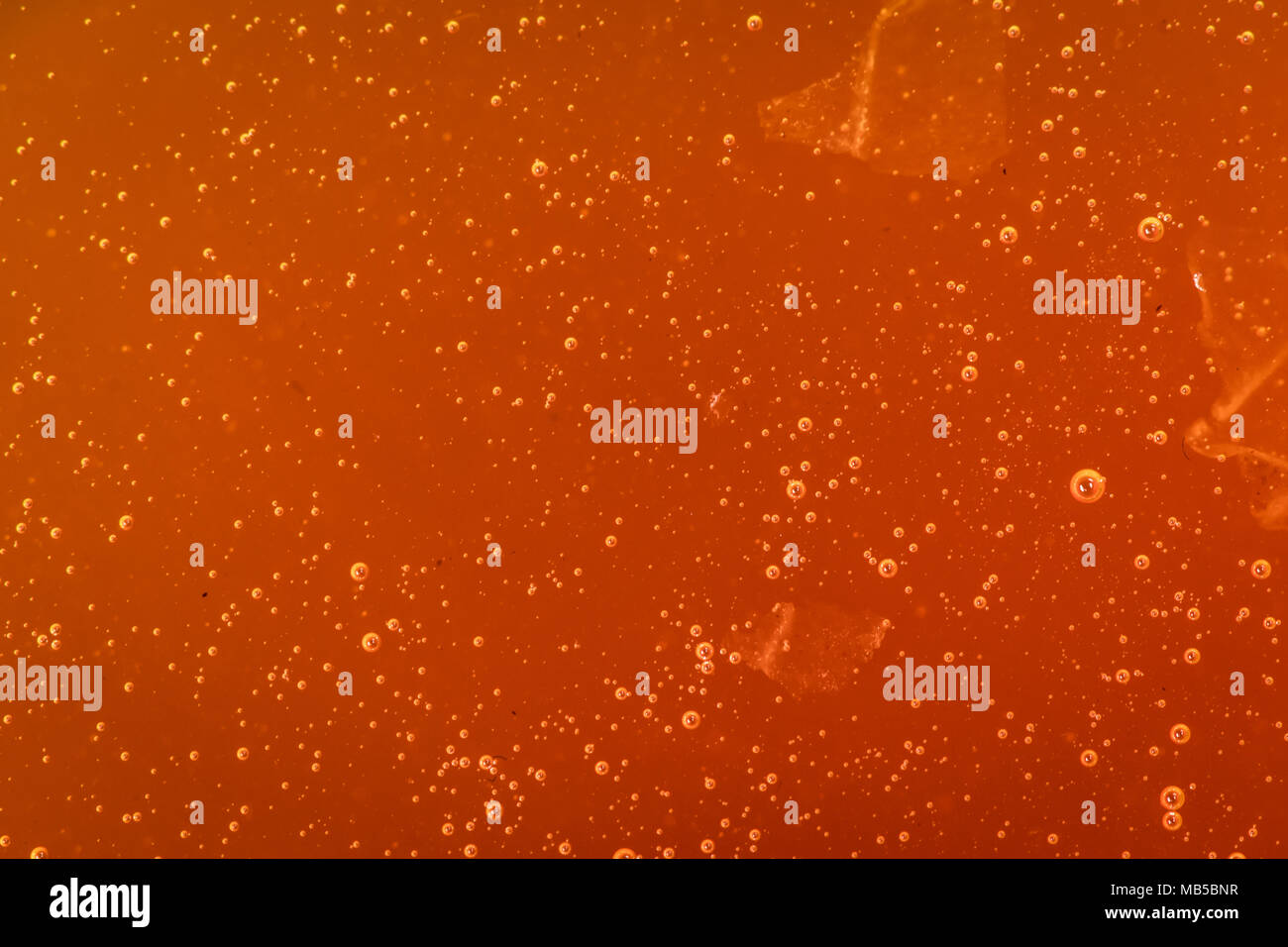 Air Bubbles in Thick Honey covering image - Stock Image