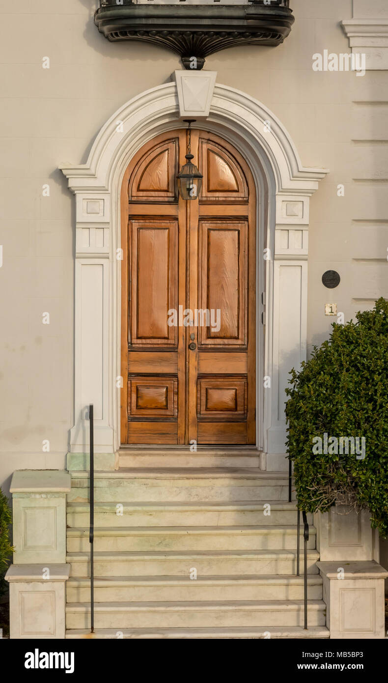 Arching Wooden Door on Old House in historic district - Stock Image