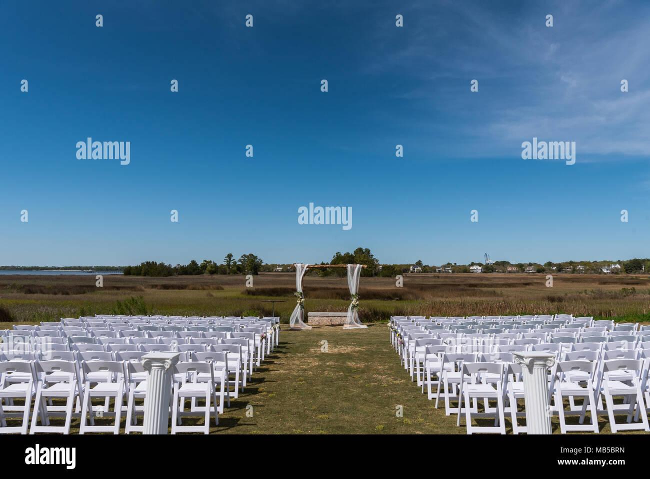 Blue Sky Above Wedding Setup in southern marsh setting - Stock Image