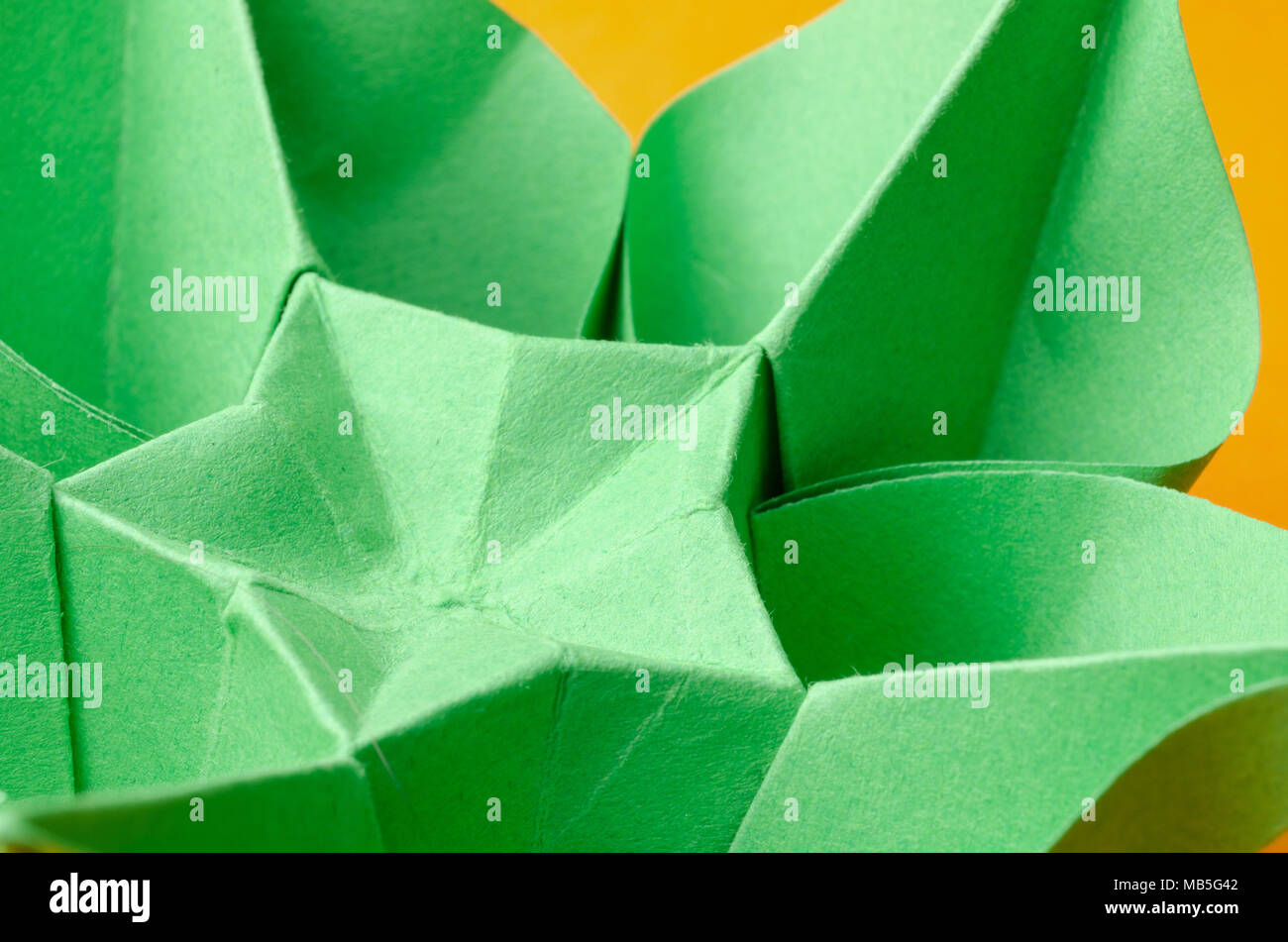 Closeup of a green paper origami flower with star shape stock photo closeup of a green paper origami flower with star shape mightylinksfo