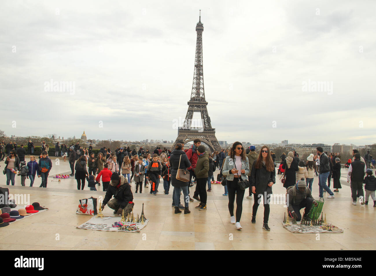 Paris, France -  02 April 2018. Tourists are seen Palais de Chaillot , Trocadero on 01 April with the Eiffel Tower seen on the background. General view of Paris, France. @ David Mbiyu/Alamy Live News - Stock Image