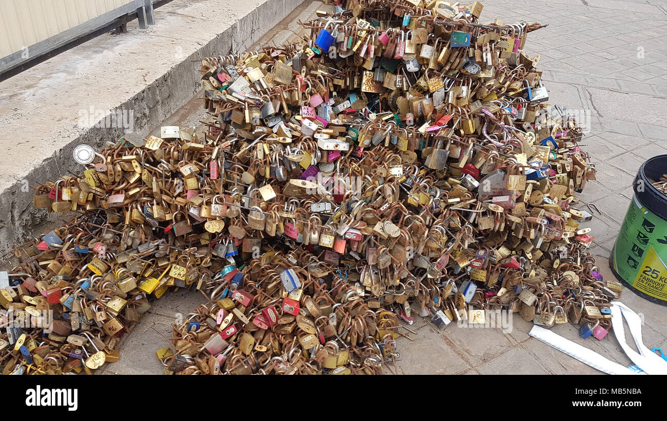 Paris, France -  03 April, 2018. Workmen remove Padlocks on the bridge at Pont Neuf on 03 April 2018.  The first Iron bridge built in France, had its railings replaced with glass panels after they collapsed under the weight on the metal padlocks and this culture has cropped up in other bridges in Paris. General view of Paris, France. @ David Mbiyu/Alamy Live News - Stock Image