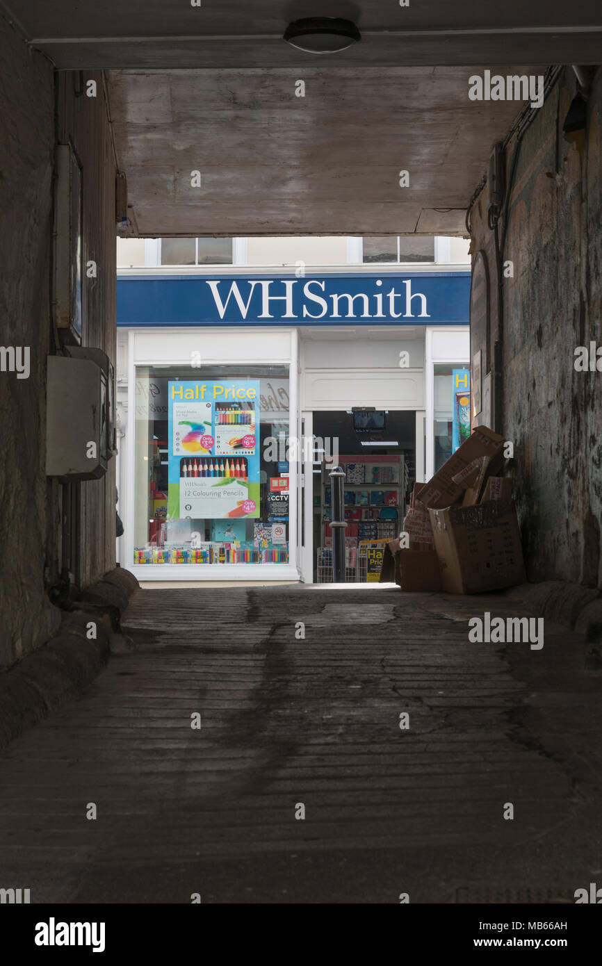 WHSmith Bodmin (Cornwall) seen through archway opposite the shop. - Stock Image