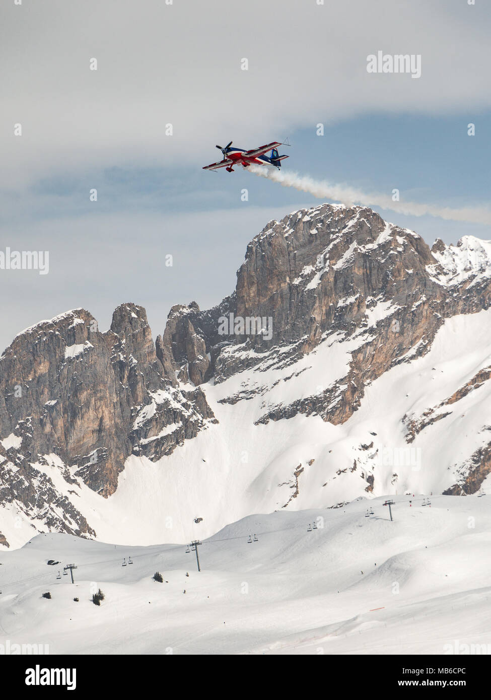 L'armee de l'air plane flying ove the Portetta mountain peak of Courchevel 1650 Moriond during the air show event Fly Courchevel 2018 acrobatic flight - Stock Image