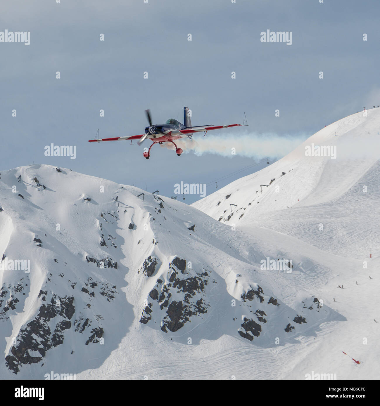 Flying over snowy mountains air shoe fly Courchevel 2018 l'Armee de l'air airplane acrobatic flight over the snow mountains of the 3 Valleys ski area - Stock Image