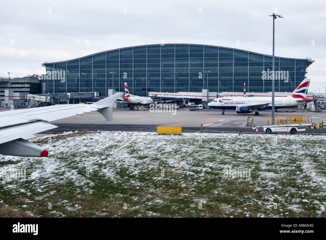Heathrow Airport, London, UK. Terminal 5, designed by the Richard Rogers Partnership and opened in 2008, is the largest building in the UK - Stock Image