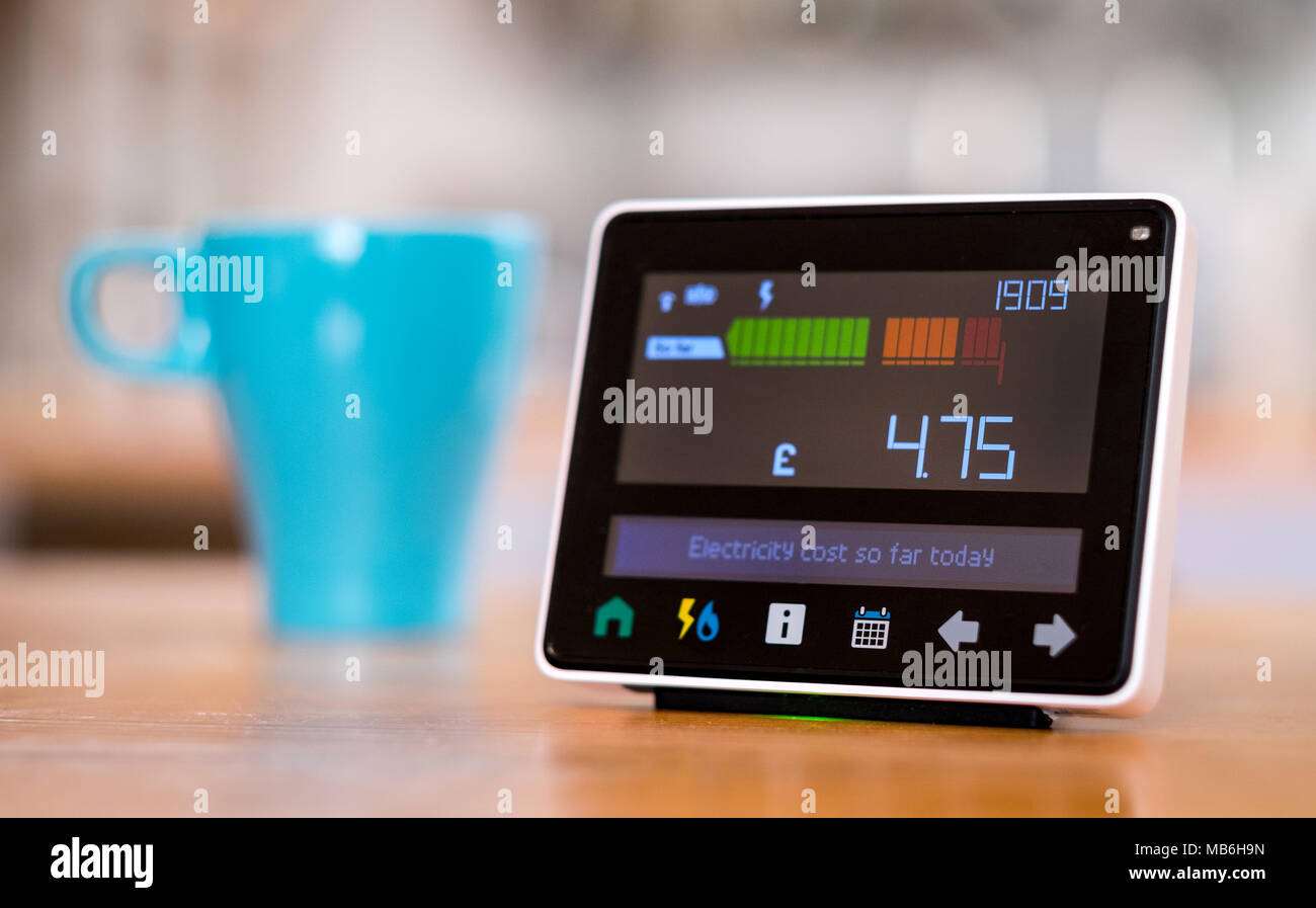 Energy monitor ( Smart Metre ) in the kitchen of a UK home Stock Photo