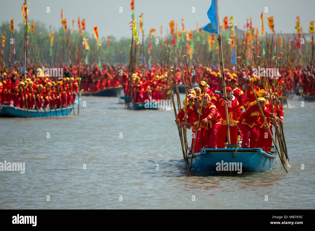 Taizhou, China's Jiangsu Province. 8th Apr, 2018. Boat team members attend the Qintong Boat Festival in Taizhou, east China's Jiangsu Province, April 8, 2018. The Qintong Boat Festival in Taizhou originated in China's Southern Song Dynasty (1127-1279 A.D.) as a ceremony to commemorate war victims around the Qingming Festival. Nowadays, this tradition is well preserved and promoted, offering spectators a view of the gathering of hundreds of boats. Credit: Tang Dehong/Xinhua/Alamy Live News - Stock Image