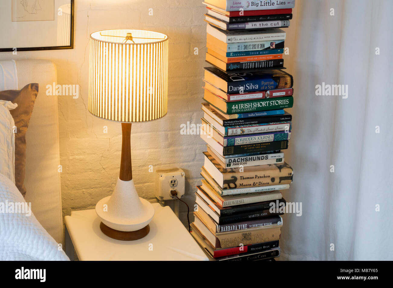 lighted-reading-lamp-and-a-stack-of-book