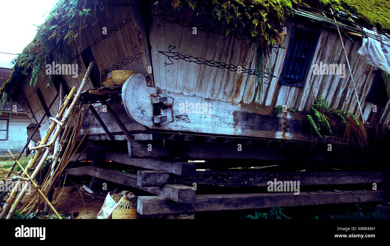 A traditional Karo Batak longhouse in Sumatra, Indonesia is standing on its last legs. It will soon collapse. - Stock Image