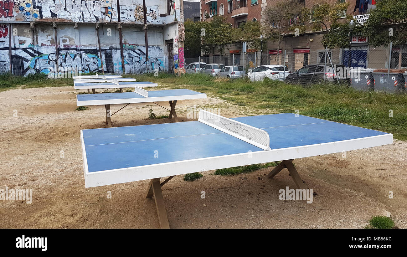 Barcelona, Spain -  30th March, 2018. Five table tennis tables by a derelict building at Carrer de Peracamps, 14 08001 Barcelona midway between La Rambla and Paral·lel Metro station.  General view of Barcelona, Spain. @ David Mbiyu/Alamy Live News - Stock Image