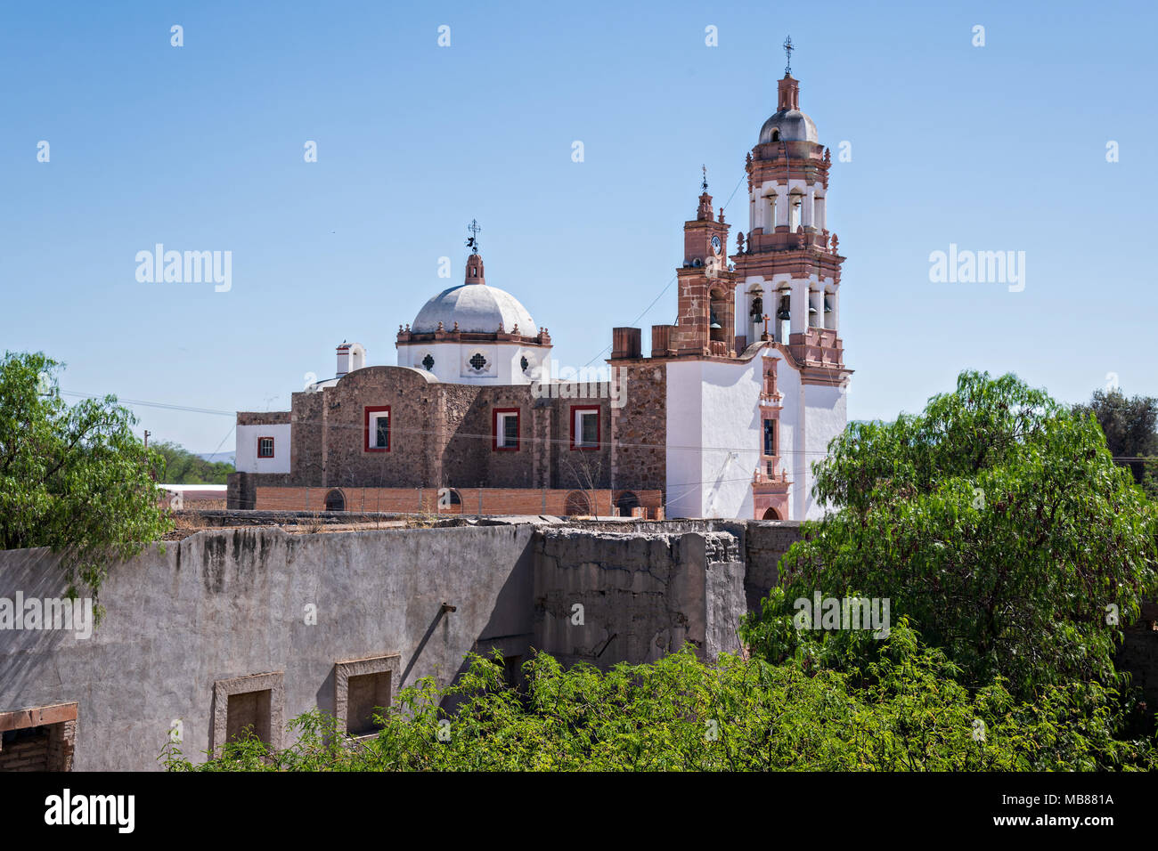 The Iglesia de San Diego De Alcalá as seen from the Hacienda de Jaral de Berrio in Jaral de Berrios, Guanajuato, Mexico. The abandoned Jaral de Berrio hacienda was once the largest in Mexico and housed over 6,000 people on the property. - Stock Image