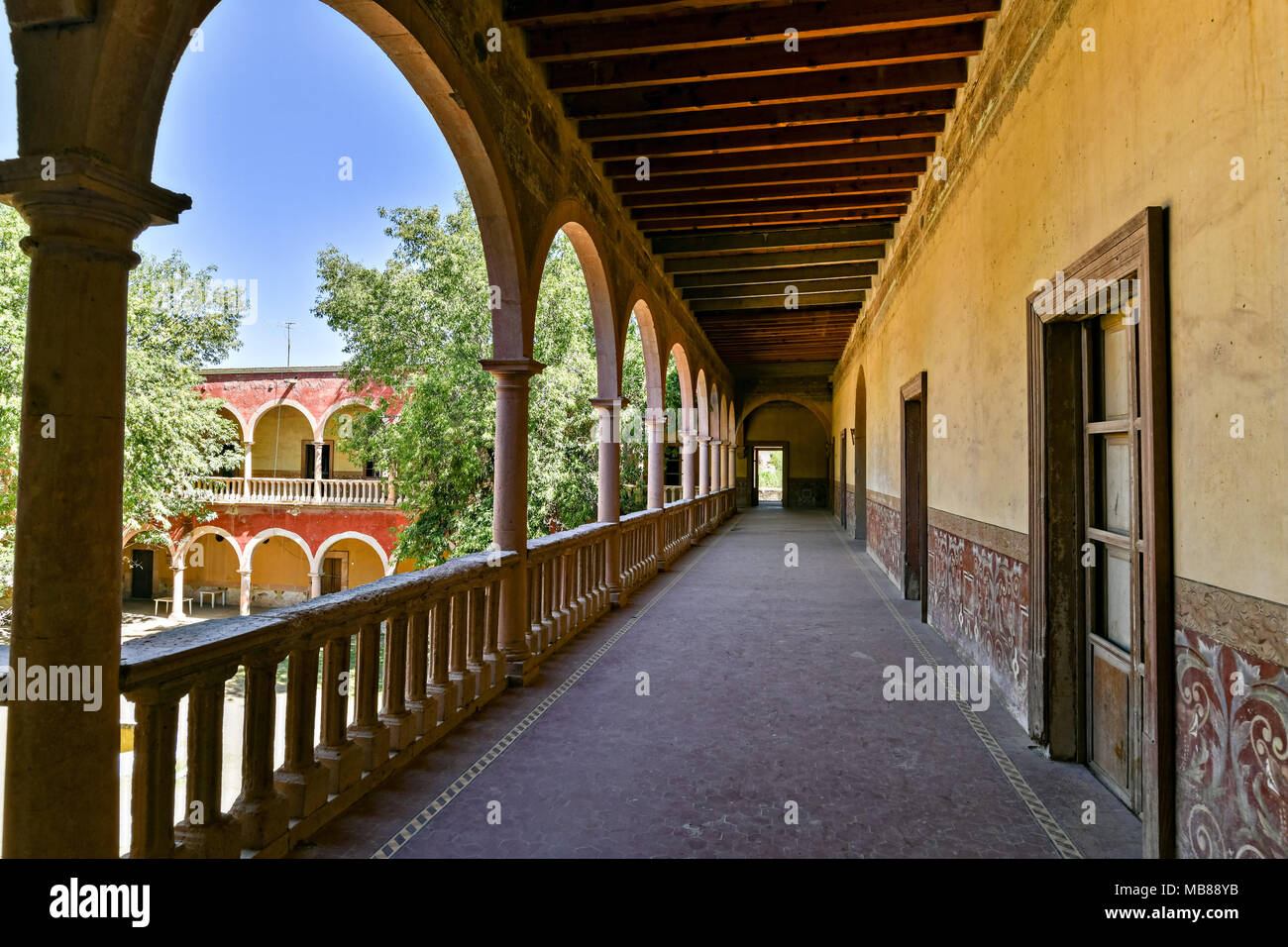 The derelict and crumbling Hacienda de Jaral de Berrio in Jaral de Berrios, Guanajuato, Mexico. The abandoned Jaral de Berrio hacienda was once the largest in Mexico and housed over 6,000 people on the property and is credited with creating Mescal. - Stock Image