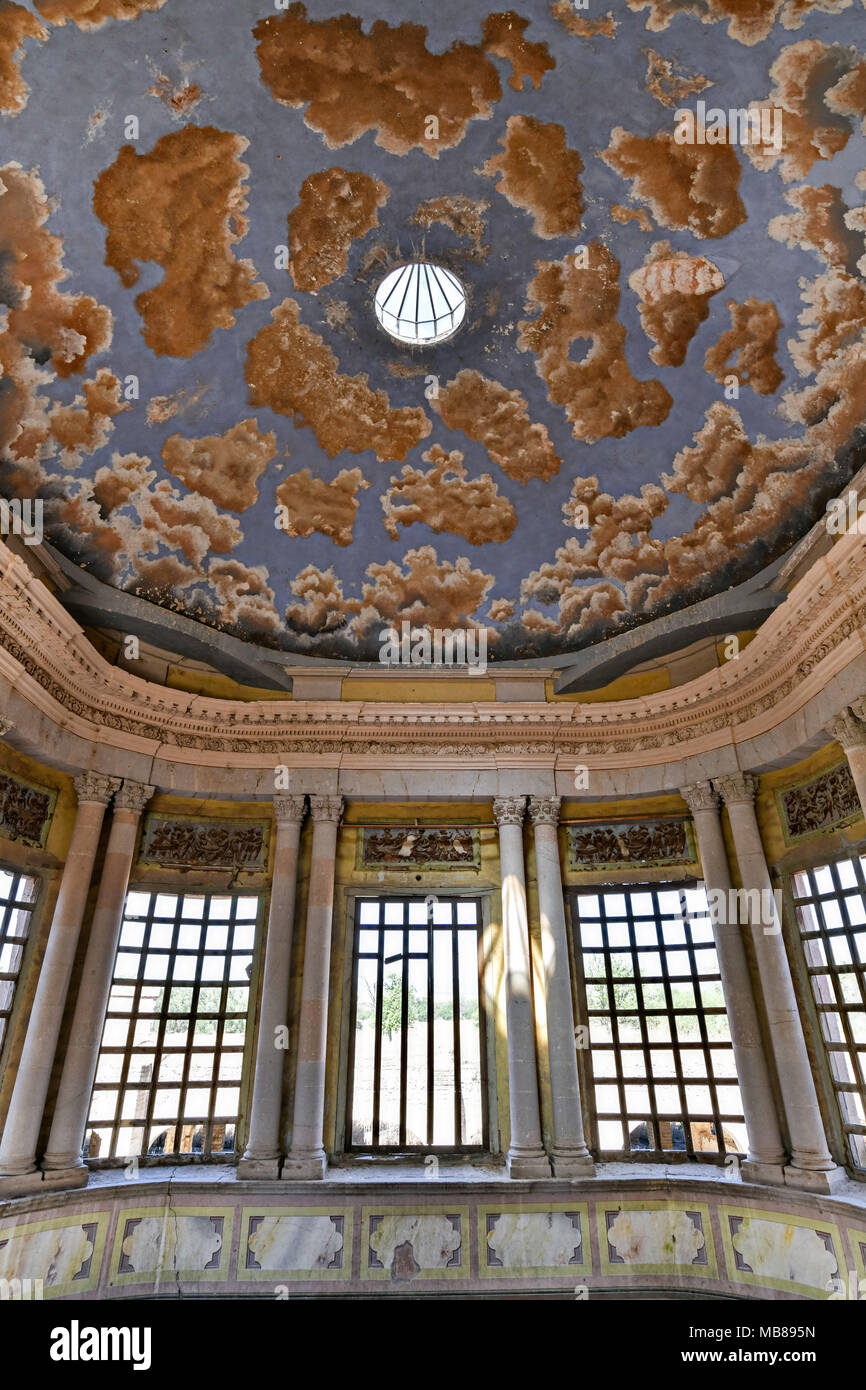 A painted ceiling on the grand stairs of the derelict and fading Hacienda de Jaral de Berrio in Jaral de Berrios, Guanajuato, Mexico. The abandoned Jaral de Berrio hacienda was once the largest in Mexico and housed over 6,000 people on the property and is credited with creating Mescal. - Stock Image