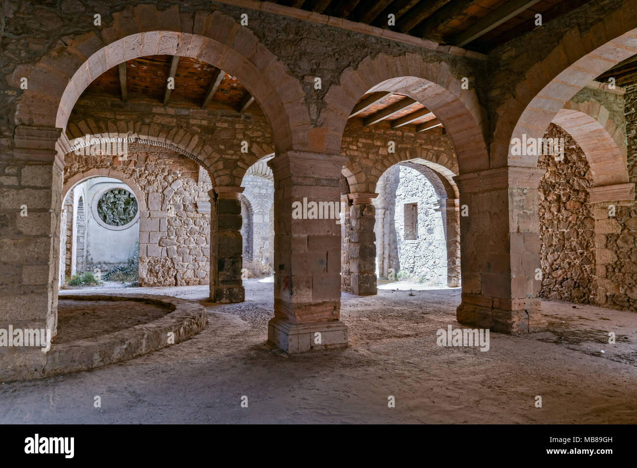 Stables under the fading Hacienda de Jaral de Berrio in Jaral de Berrios, Guanajuato, Mexico. The abandoned Jaral de Berrio hacienda was once the largest in Mexico and housed over 6,000 people on the property and is credited with creating Mescal. - Stock Image
