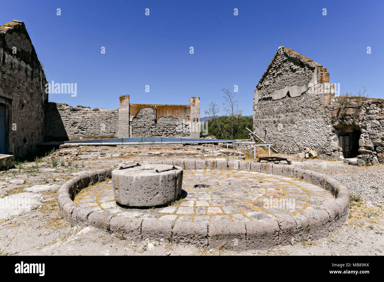 The ruins of a palenque for making Mezcal at the fading Hacienda de Jaral de Berrio in Jaral de Berrios, Guanajuato, Mexico. The abandoned Jaral de Berrio hacienda was once the largest in Mexico and housed over 6,000 people on the property and is credited with creating Mescal. - Stock Image