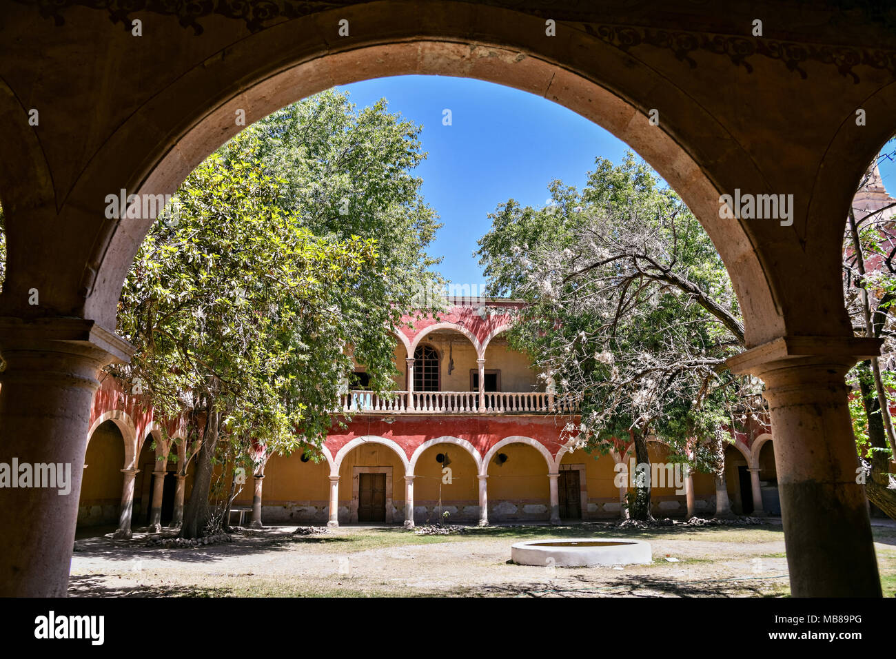 The Iglesia de San Diego De Alcalá as seen from the entry to the Hacienda de Jaral de Berrio in Jaral de Berrios, Guanajuato, Mexico. The abandoned Jaral de Berrio hacienda was once the largest in Mexico and housed over 6,000 people on the property. - Stock Image