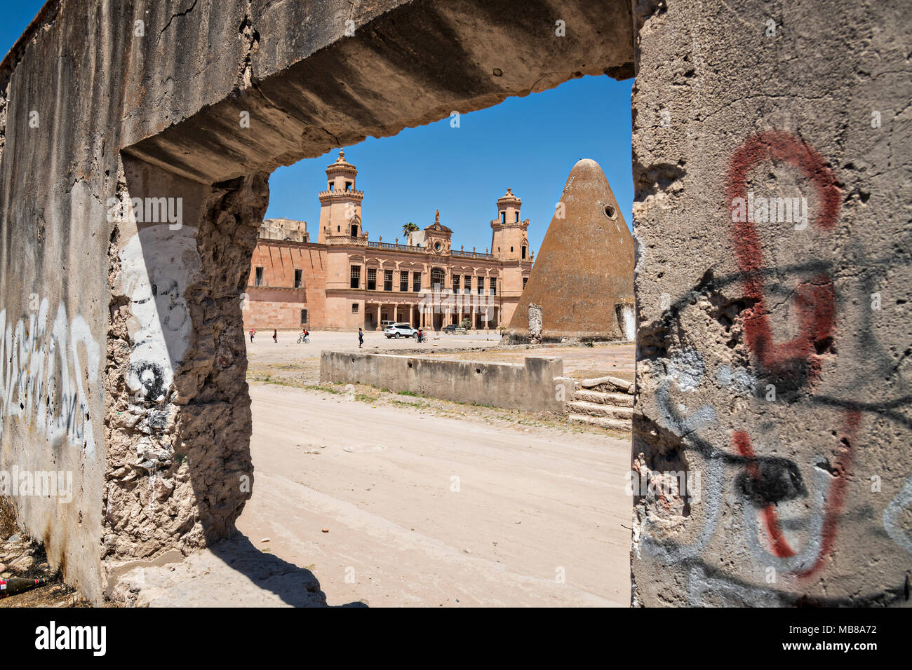 The pyramid shaped granaries and the front towers of the Hacienda de Jaral de Berrio in Jaral de Berrios, Guanajuato, Mexico. The abandoned Jaral de Berrio hacienda was once the largest in Mexico and housed over 6,000 people on the property and is credited with creating Mescal. - Stock Image
