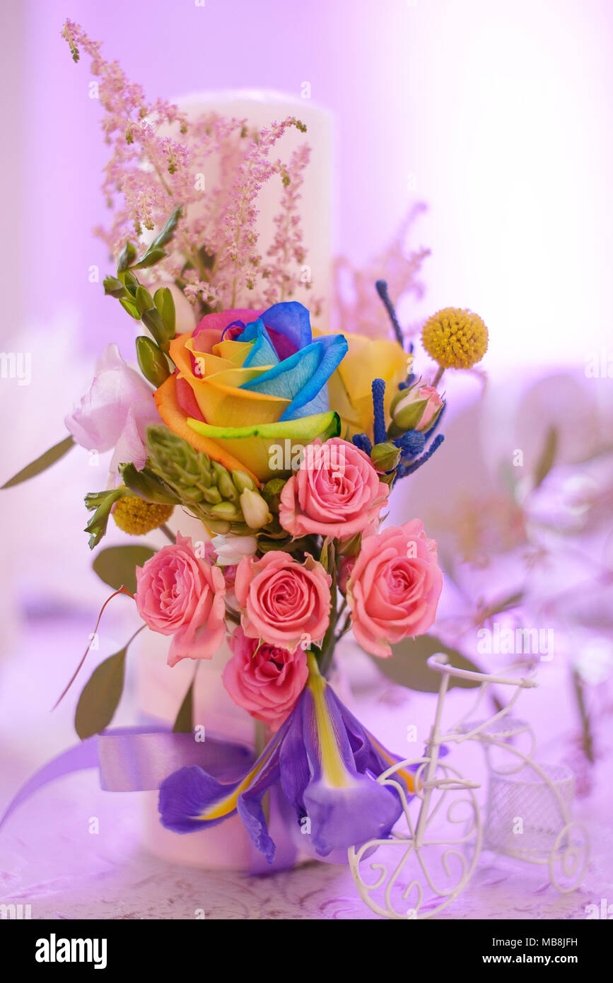 Floral arrangement with fancy rainbow colored roses as beautiful ...