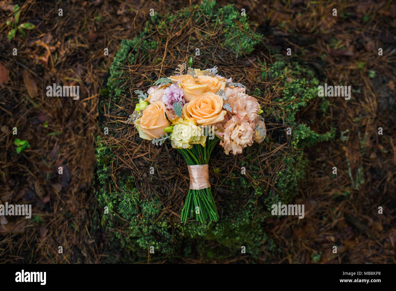 Closeup top view of beautiful wedding bouquet of flowers isolated on closeup top view of beautiful wedding bouquet of flowers isolated on natural brown background horizontal color photography izmirmasajfo