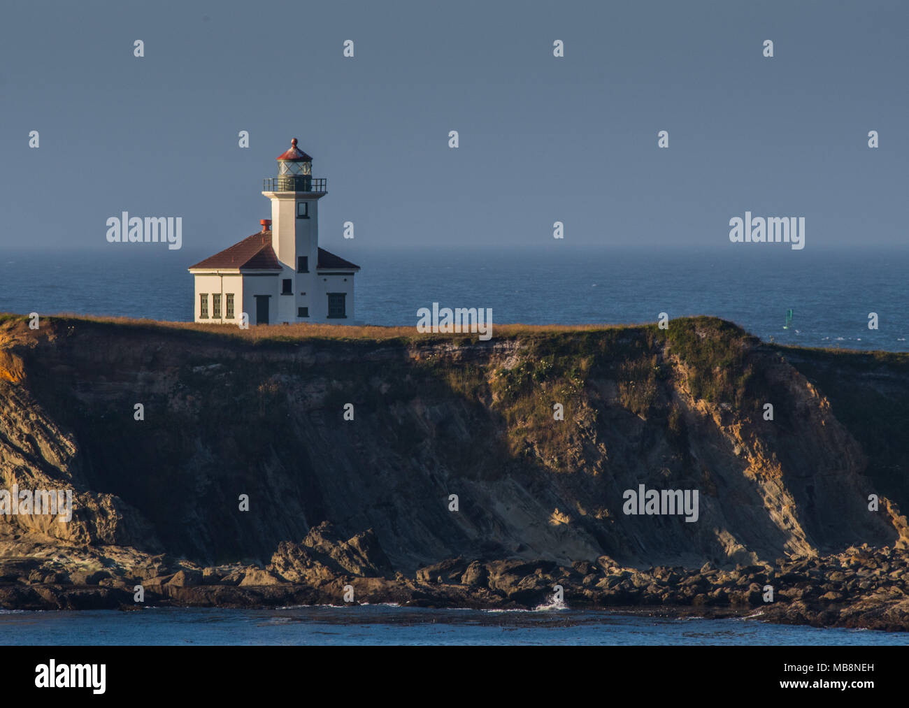 Cape Arago Lighthouse Perched Atop a Cliff Along the Oregon Coast - Stock Image