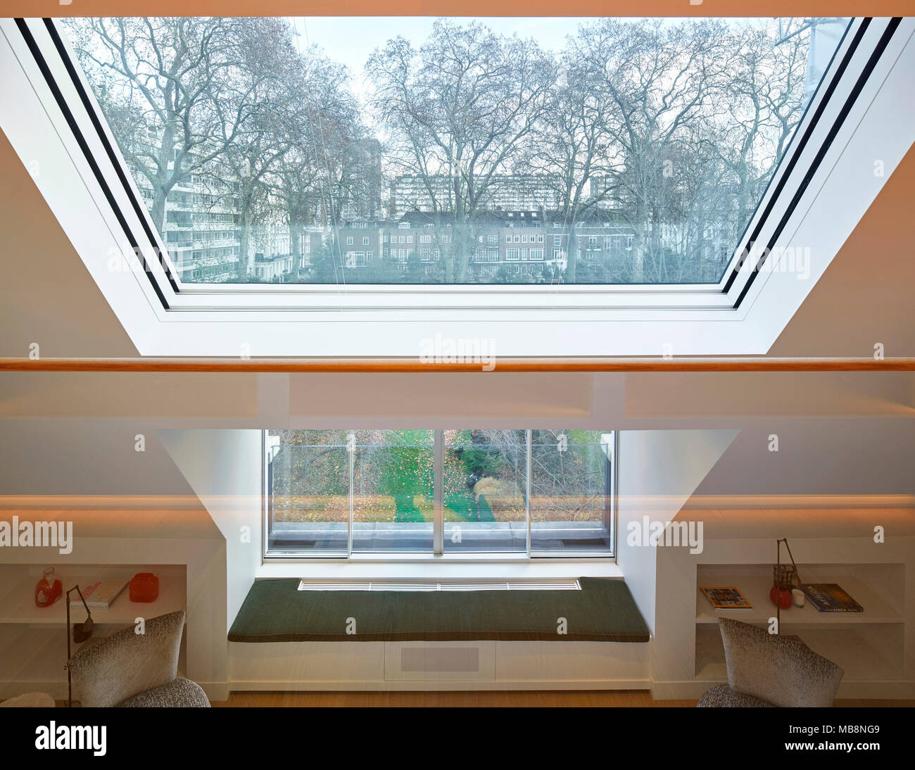 Double height space looking over communal gardens. Private residence, London, United Kingdom. Architect: PTP , 2017. - Stock Image