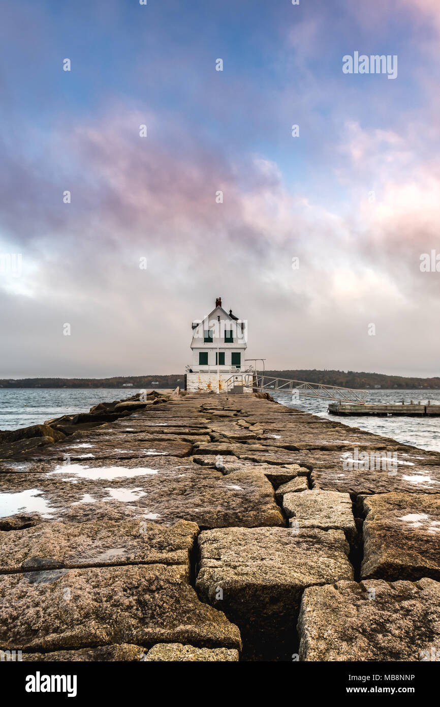 Colorful Clouds Above The Rockland Harbor Breakwater Lighthouse in Maine - Stock Image
