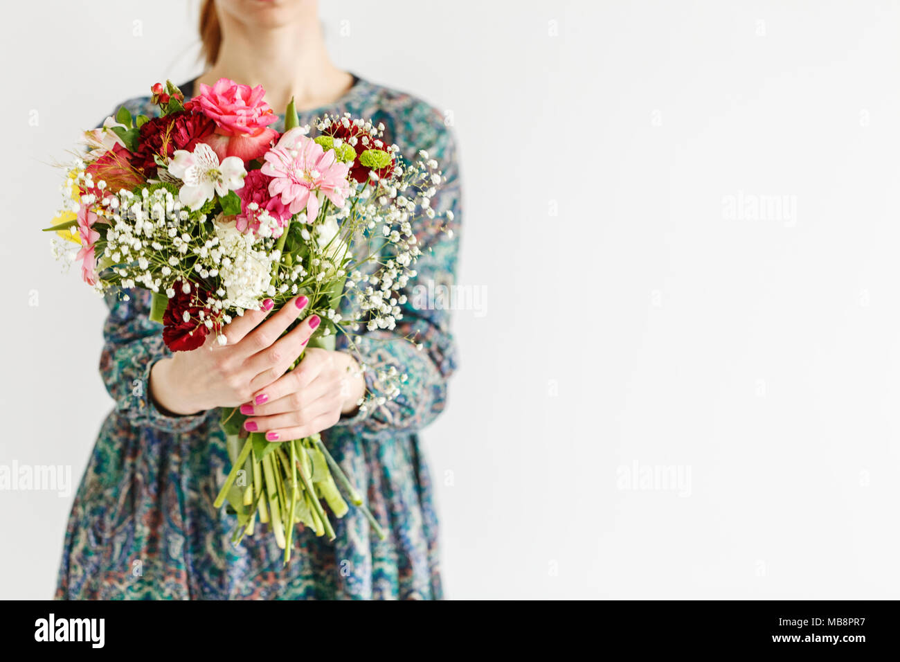 Young woman giving a beautiful bouquet of fresh flowers to her young woman giving a beautiful bouquet of fresh flowers to her mother for mothers day izmirmasajfo