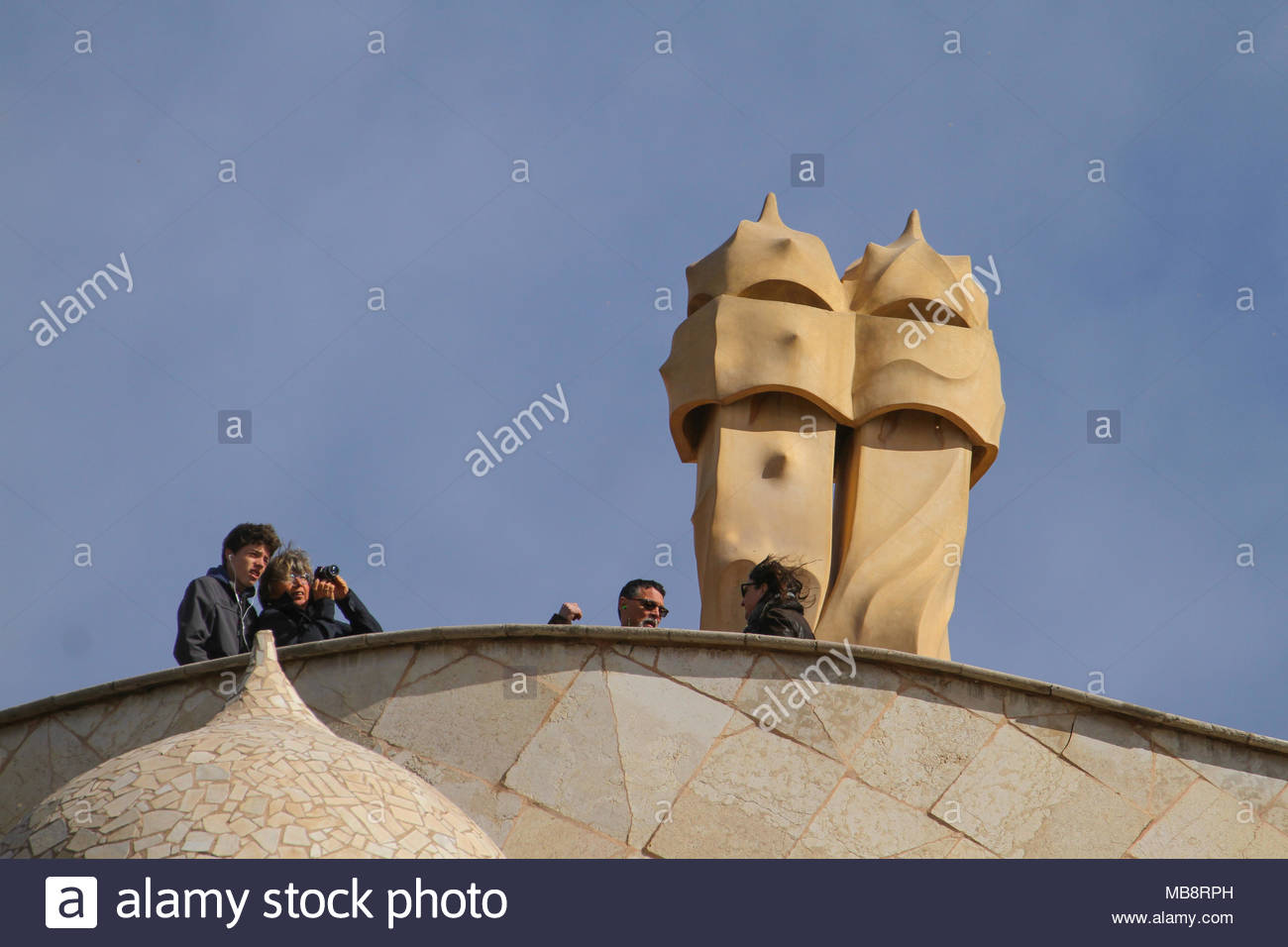 Barcelona, Spain -  31st March, 2018. Tourists seen by chimneys on the Casa Mila on 31 March. The modernist building in Barcelona, Catalonia, by architect Antoni Gaudi Barcelona was built between 1906 and 1912.. General view of Barcelona, Spain. @ David Mbiyu/Alamy Live News - Stock Image