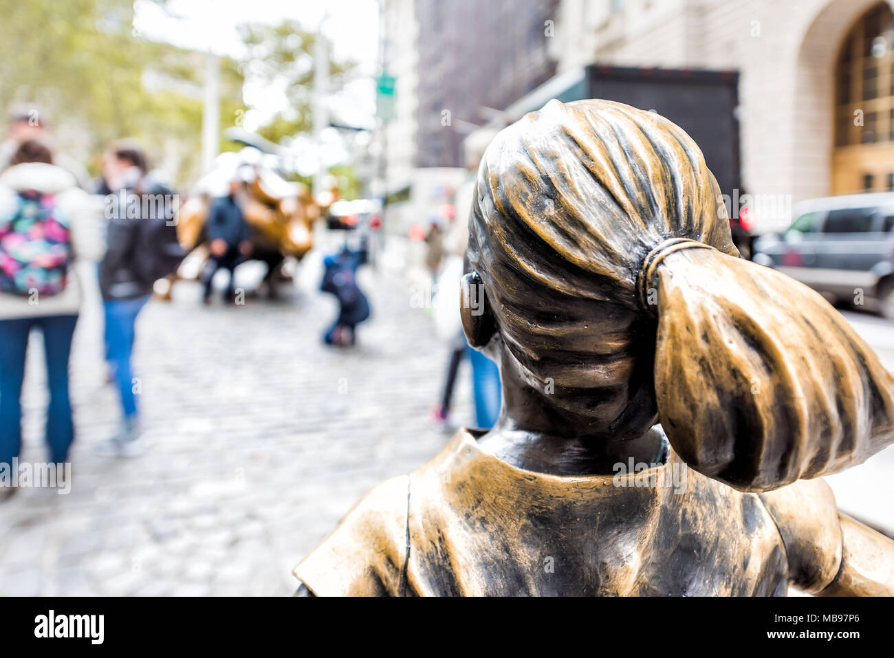 New York City, USA - October 30, 2017: Wall Street stock exchange The Fearless Girl statue facing Charging Bull metal in NYC Manhattan lower financial - Stock Image