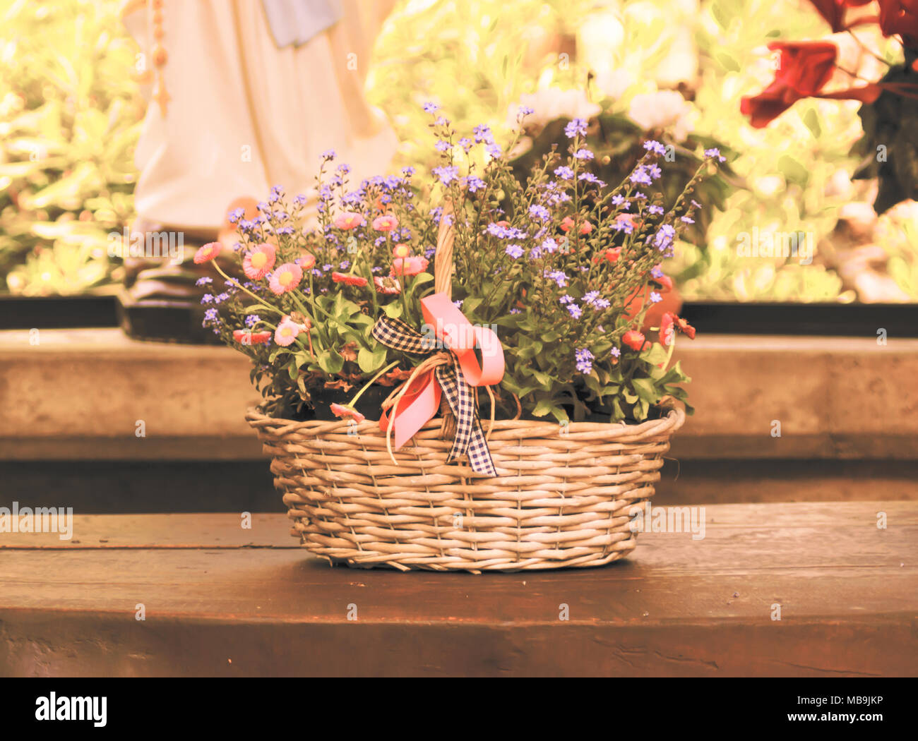 Wicker Basket With Bouquet Of Beautiful Flowers Background In A