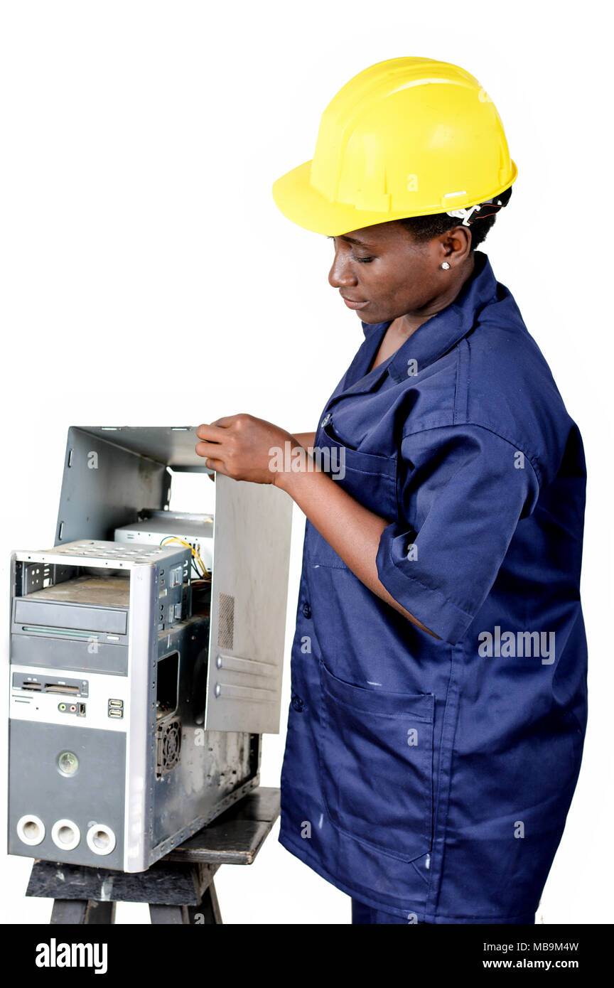Young female computer maintenance worker checks the status of a computer CPU. - Stock Image