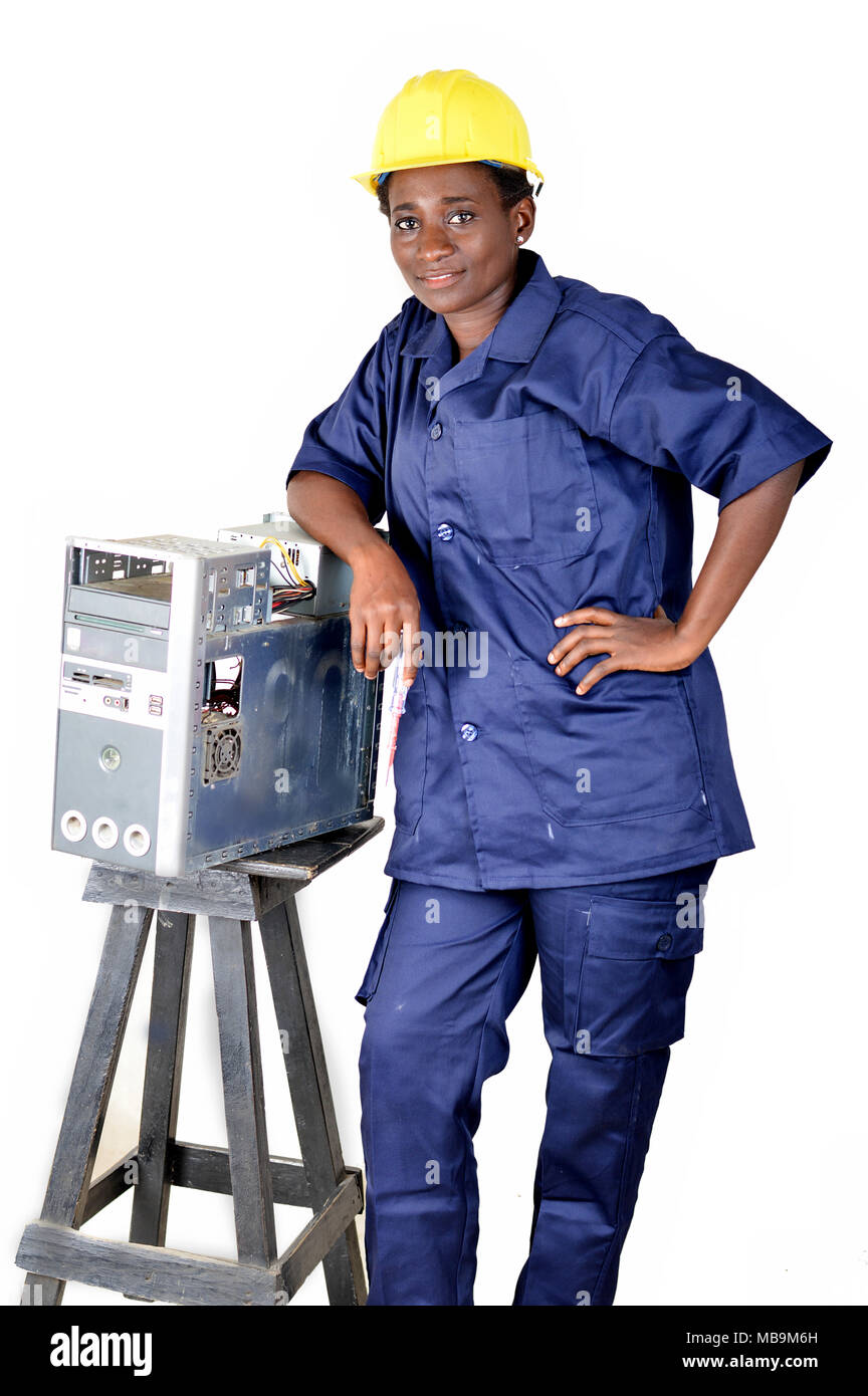 Young woman smiling in uniform standing, elbow on a desktop disassembled - Stock Image