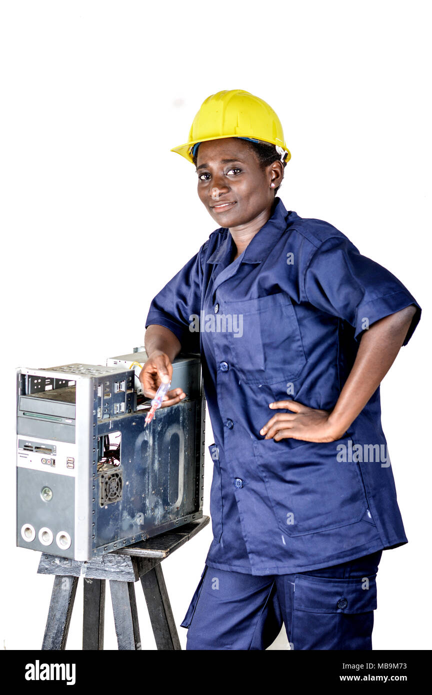 Young woman smiling in uniform standing, elbow on a desktop disassembled. - Stock Image