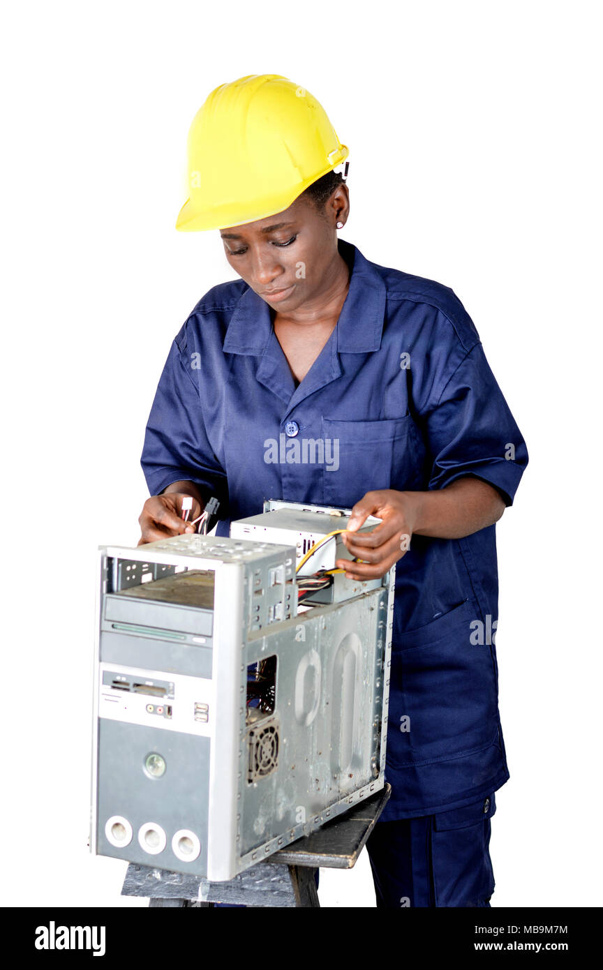 Computer maintenance technician tests the electrical circuits of the computer. - Stock Image