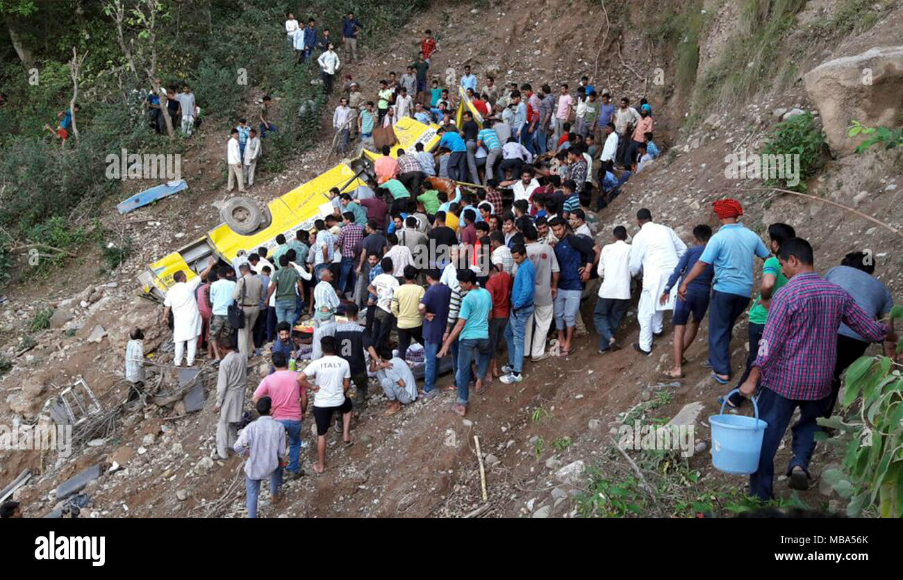 Himachal Pradesh. 9th Apr, 2018. People gather at the site of a traffic accident in Kangra district of Himachal Pradesh, India, April 9, 2018. Around 20 school children were feared dead in India's northern state of Himachal Pradesh on Monday evening, when the school-bus they were travelling in fell into a deep gorge, a senior state government official confirmed to Xinhua. Credit: Xinhua/Alamy Live News - Stock Image