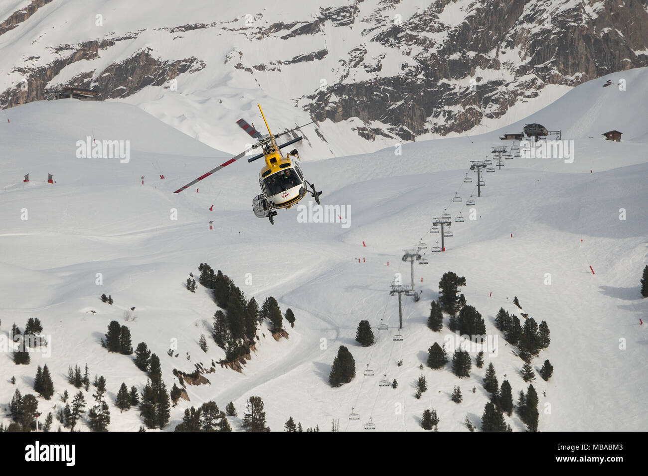 Helicopter Flying Over A Ski Resort Courchevel 3 Valleys Savoie Rhone Alpes France Europe - Stock Image