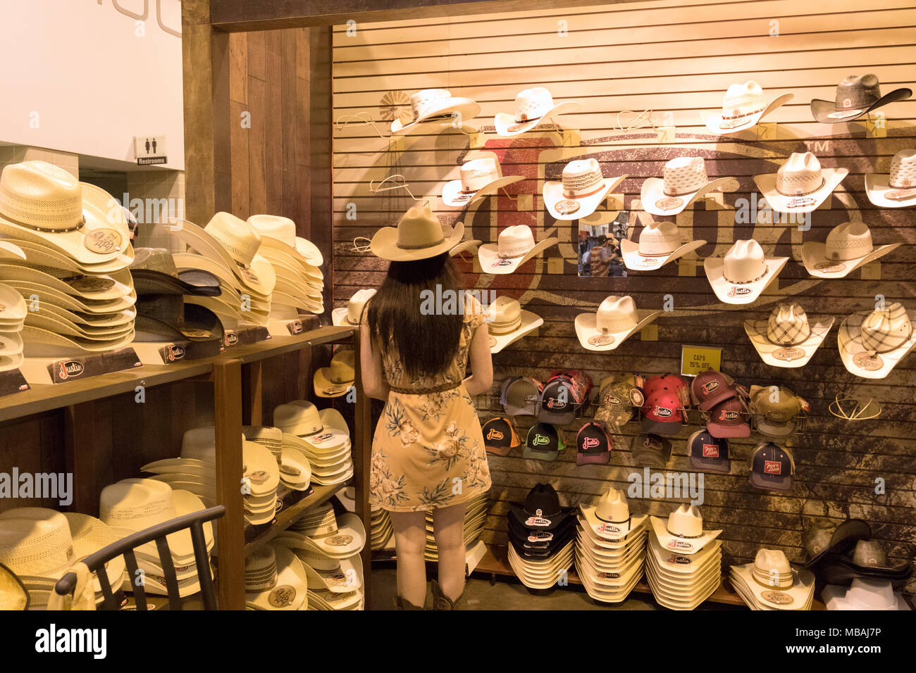 Woman in a cowboy hat store 3f28f7a811b