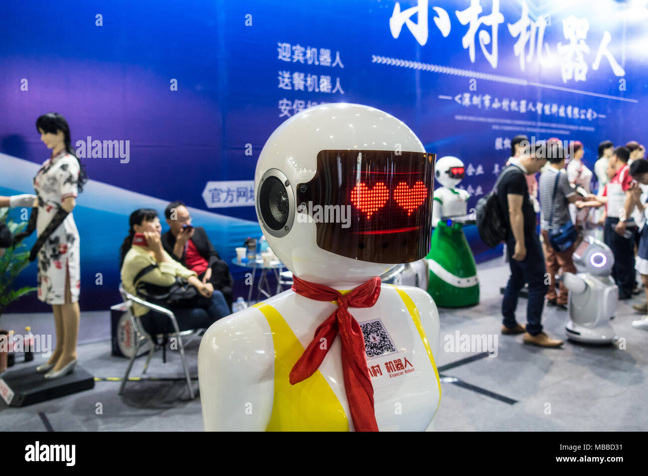 Human-like robot (humanoid robot) with heart eyes at technology fair in Shenzhen, China. - Stock Image