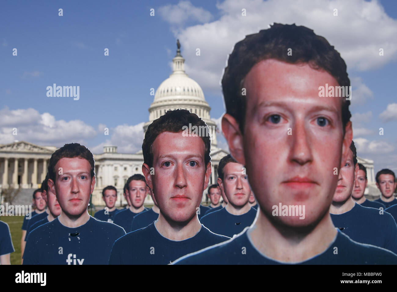 Washington, District Of Columbia, USA. April 10, 2018 - Washington, District Of Columbia, USA - 100 life size cutouts of Facebook CEO Mark Zuckerberg outside the United States Capitol on the day that Zukerberg will testify before Congress on Capitol Hill in Washington, DC on April 10, 2018. Credit: Alex Edelman/ZUMA Wire/Alamy Live News Credit: ZUMA Press, Inc./Alamy Live News - Stock Image