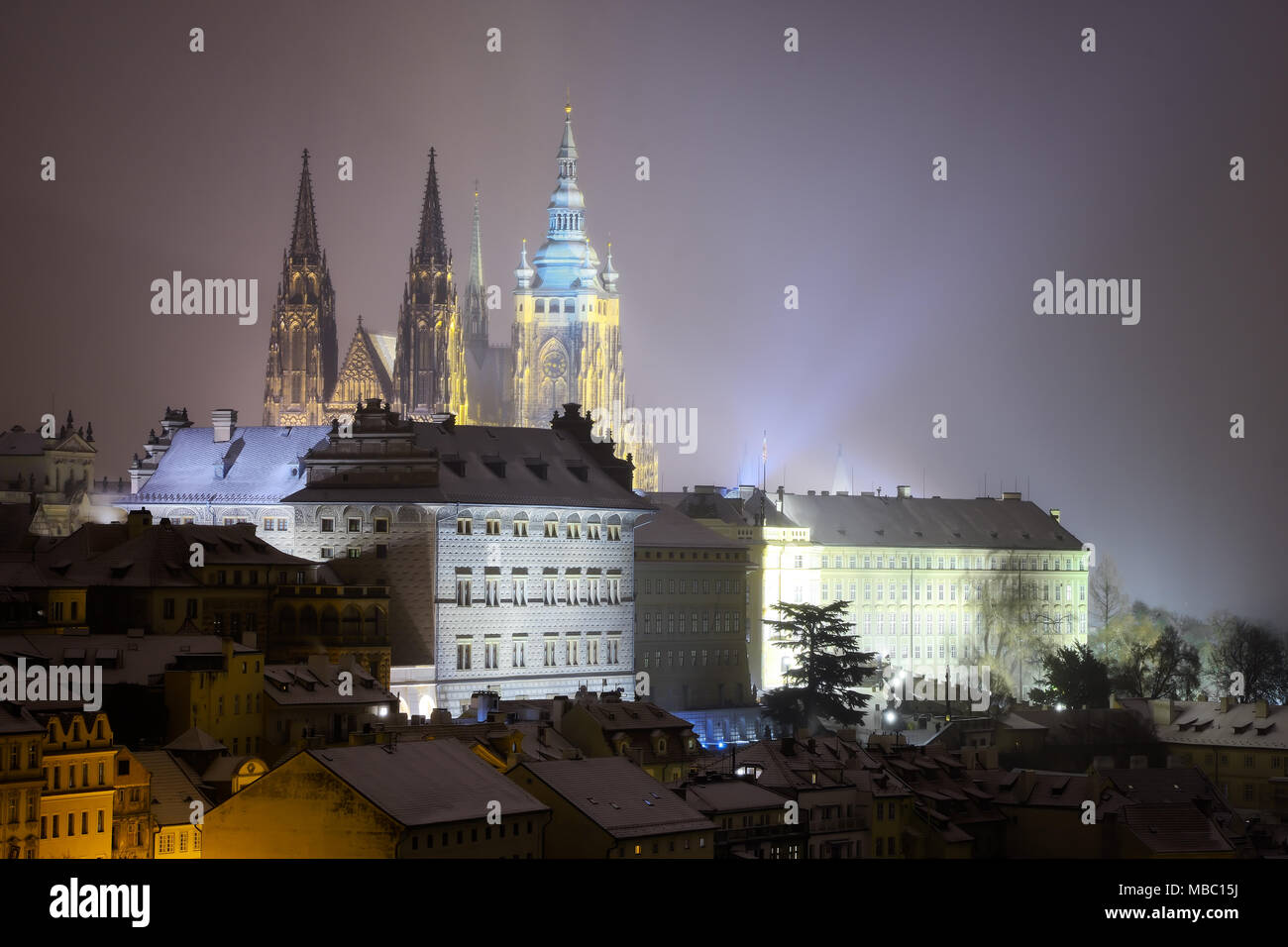 Saint Vitus Cathedral. Snowy atmosphere during winter night. Church covered with snow. Deatil of gothic building. Unesco, Prague, Czech republic - Stock Image
