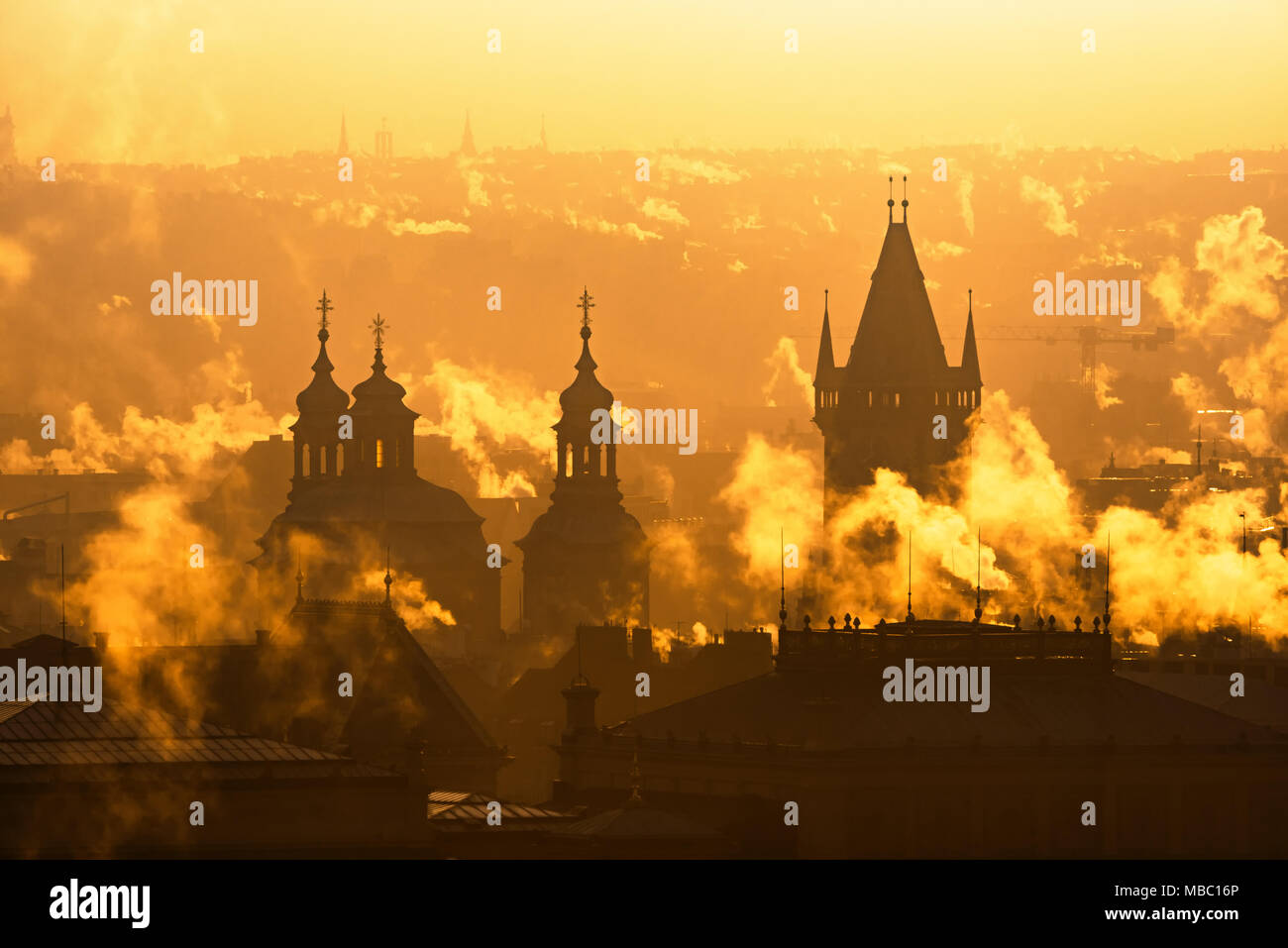 Prague foggy sunrise with historical architecture silhouette, Czech republic. - Stock Image